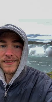 Eric Myers standing in front of Niagra Falls.