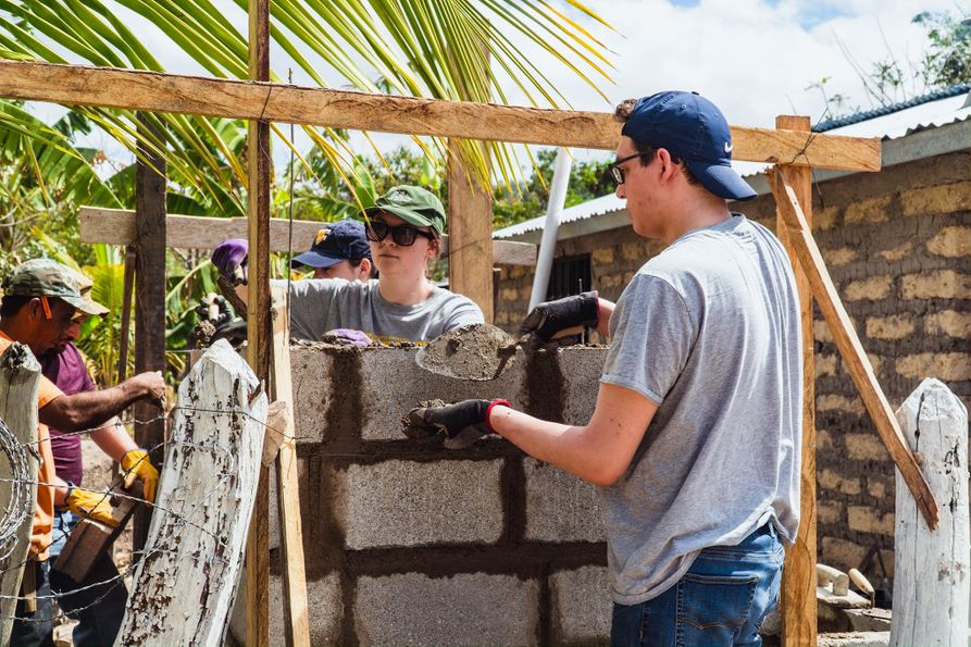 Nick Miller and the rest of his group help build a sanitation station at the home of a community member in rural Honduras in 2019.