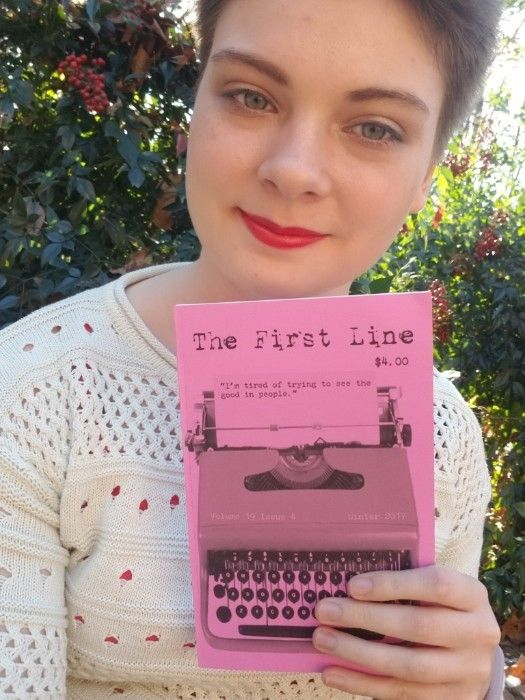 "Jessica Hogbin, holding ""The First Line"" magazine."