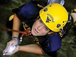 image of student rock climbing