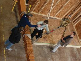 image of students building a house