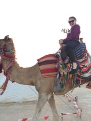 Emma Harrison riding a camel