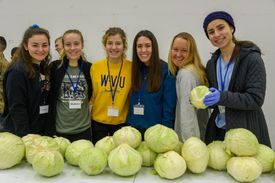 Christina White and classmates with produce