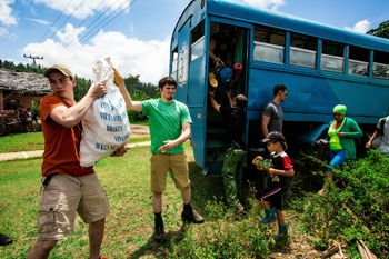 Students helping unload van in Cuba
