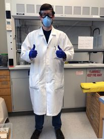 Tyler Davidson in the lab wearing PPE