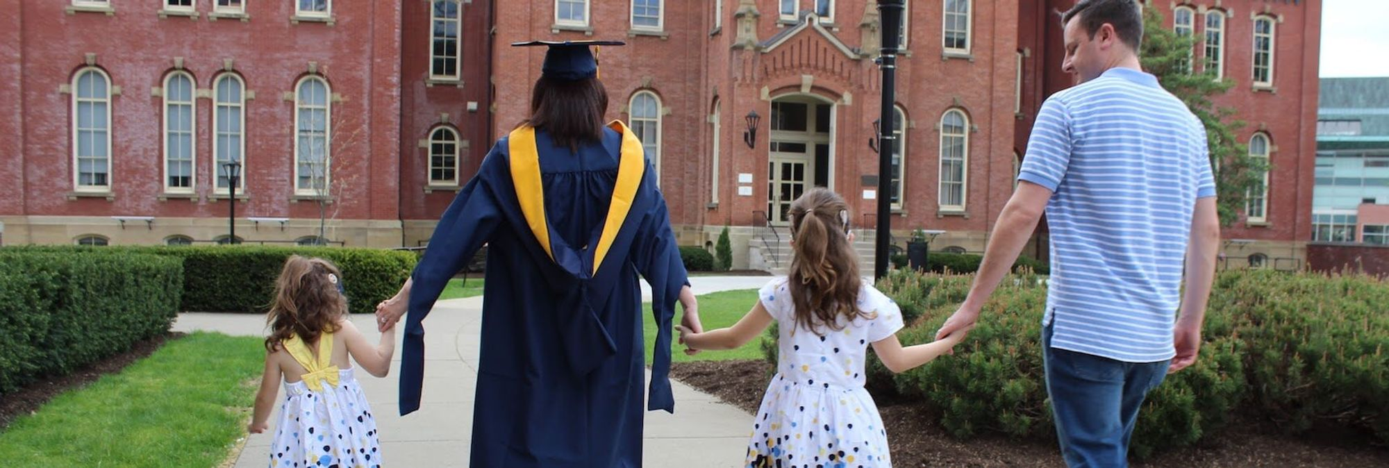 WVU family walking holding hands