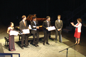 student and faculty receive awards on stage