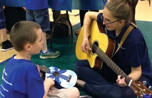 Music therapy student with child