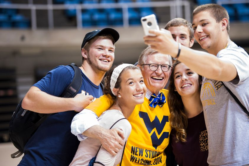 President Gee taking a selfie with students