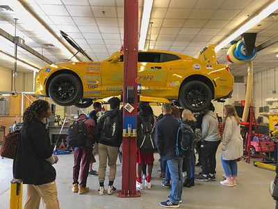 HSTA students touring the EcoCAR garage.