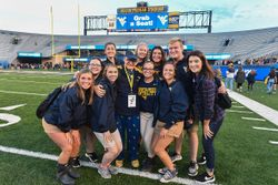 WVU President Gordon Gee poses for a photograph with a group of new students