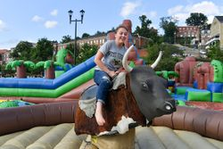 Riding mechanical bull at Welcome Carnival