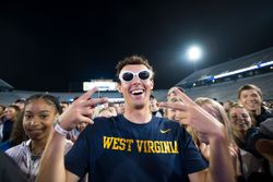 Freshmen pose for pictures on Mountaineer Field at Monday Night Lights