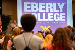 Eberly College students talk with friends