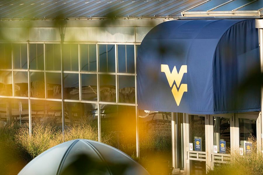 Flying WV logo on canopy over entrance to Mountainlair from the plaza