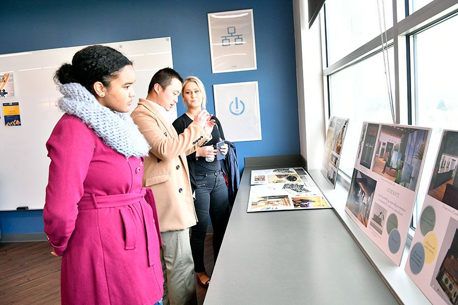 Guests look at Demo Day exhibits