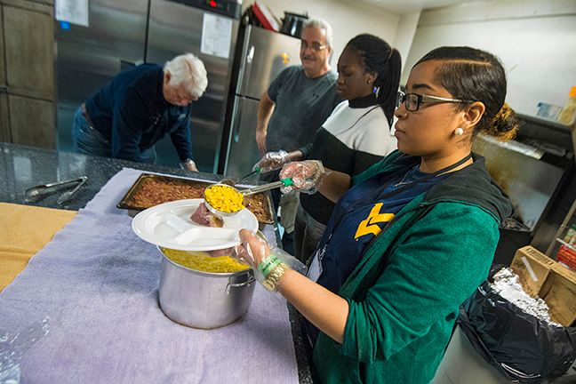 Plating food at a soup kitchen