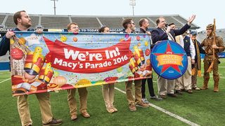 Band officials announce their invitation to the 2016 Macy's Parade at halftime of the Gold-Blue spring football game.
