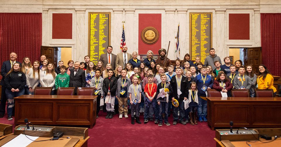 Participants pose for group photo in House chamber