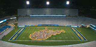 Class of 2019 inside the band's West Virginia outline at Milan Puskar Stadium