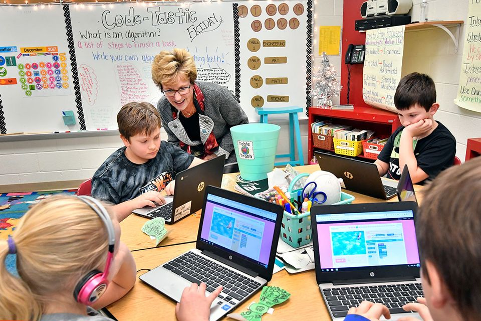 Gayle Manchin talks to third graders during The Hour of Code