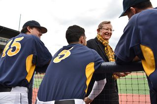 President Gee shaking hands with players