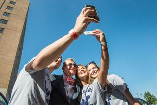 President Gee and students take a selfie outside of Towers