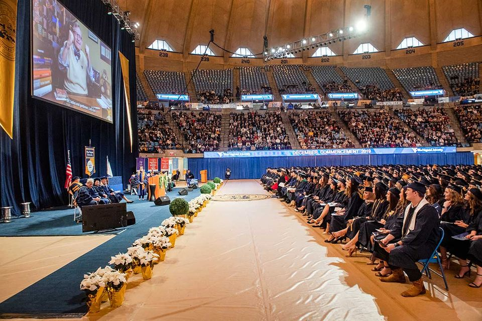 Graduates watch video of President Gee at Commencement