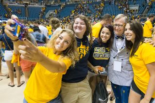 President Gee poses with students for a selfie