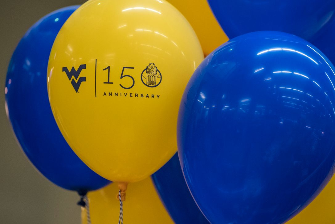 Gold and blue balloons with 150th anniversary logo