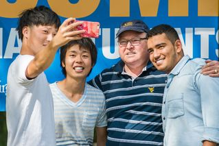 International students take a selfie with Tom Sloane.