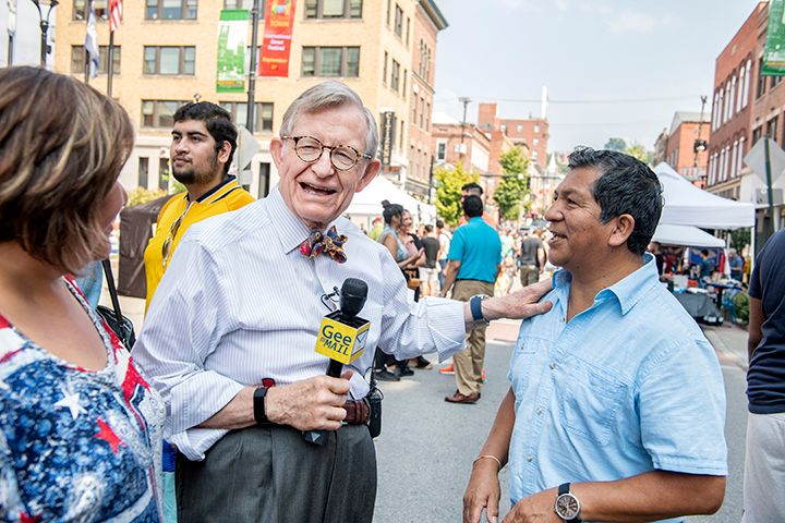 President Gee holds Gee Mail microphone as he talks to festival-goers