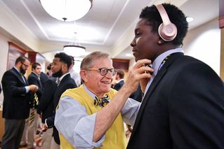 President Gee ties bow ties for players