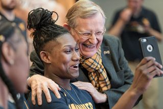 President Gee with women's basketball player