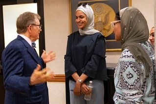 President Gee speaks to two students