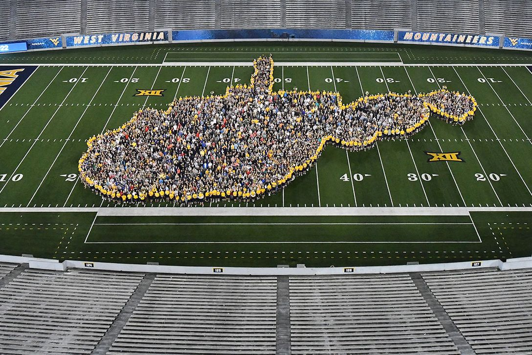New students gather inside state outline formed by WVU marching band