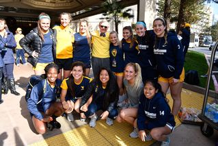 President Gee with WVU women's soccer players