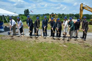 WVU officials shovel dirt at groundbreaking ceremony.