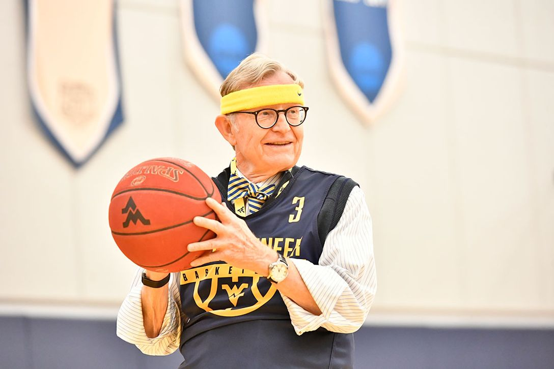 President Gee holds a basketball