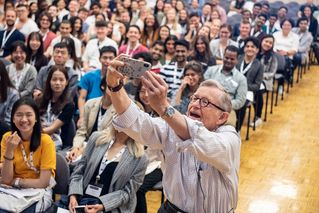 President Gee snaps a selfie with the audience