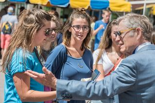 President Gee talking with students