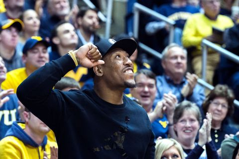 Bruce Irvin at a men's basketball game