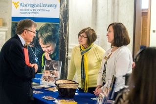 President Gee talks with College of Education and Human Service staff members
