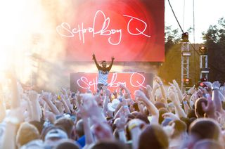 ScHoolboy Q performs on stage.
