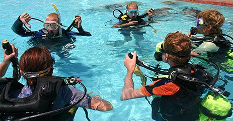 Scuba divers practicing in a pool