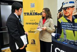 Student talking to a CMX recruiter at a career fair