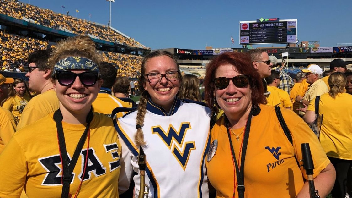Wanda Hembree (right) with her daughters at WVU stadium