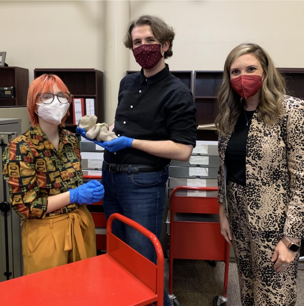 """WVU Undergradate students Riley """"Red"""" Klug (left) and Samuel Hensley (center) with Teaching Assistant Professor of Art History Megan Leight (right),"""