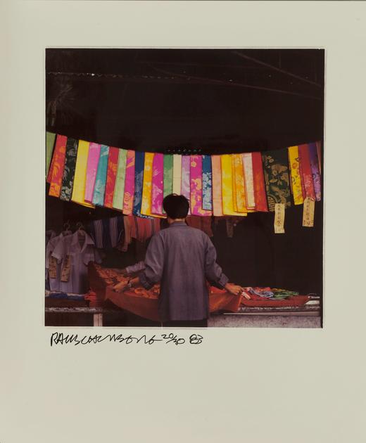 Artwork of man looking at hanging silk