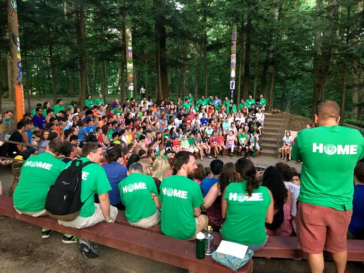 State 4-H Camps; large group of 4-H campers gather for council circle around fire pit